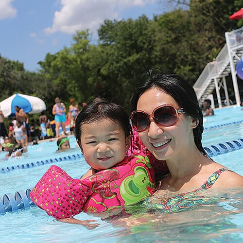 mom and baby in pool