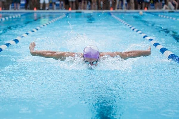 a swimmer doing laps in the pool
