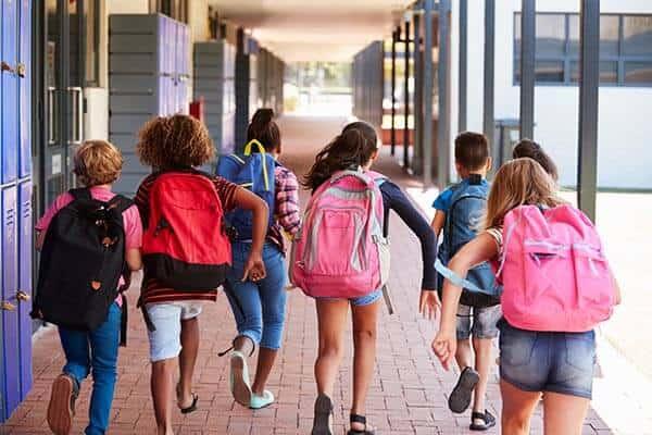 School kids walking in the hallway