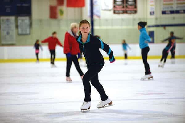 Young teenage girl ice skating