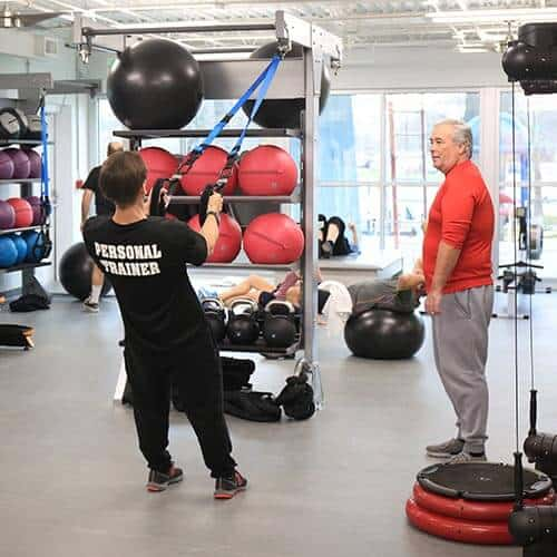 Personal trainer demonstrating an exercise to a client
