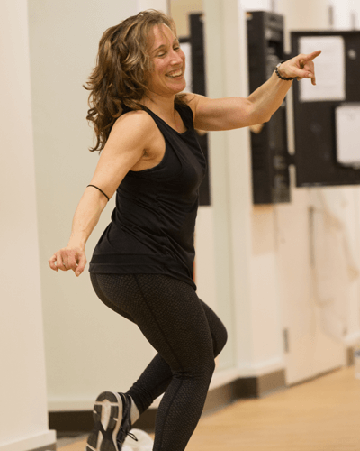 Female Trainer in Gym Zumba Class