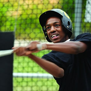 teenage boy in batting cage