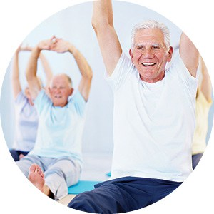 elderly mail exercising with hands raised above his head