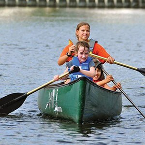lady and little boy in canoe