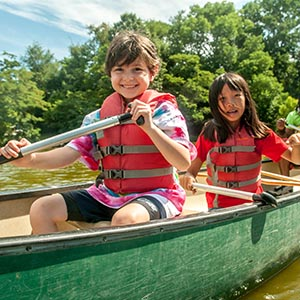 little girl and boy canoeing at lake elkhorn