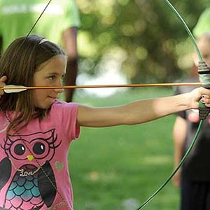 little girl shooting bow and arrow