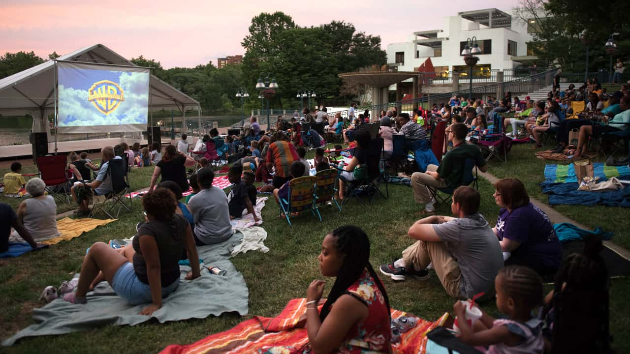 people watching a movie on the lakefront