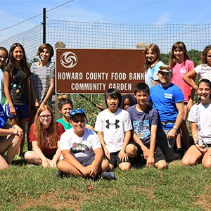 kids posing by the Howard County Food Bank Community Garden