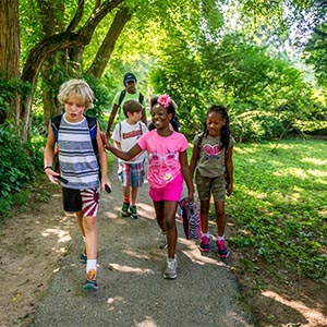 a group of diverse kids walking through the park
