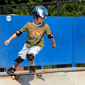 little boy on skateboard